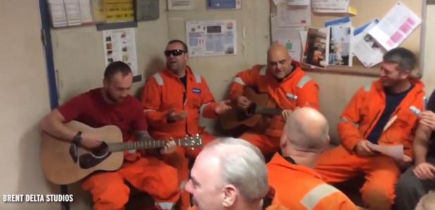Oil rig workers sing Oasis