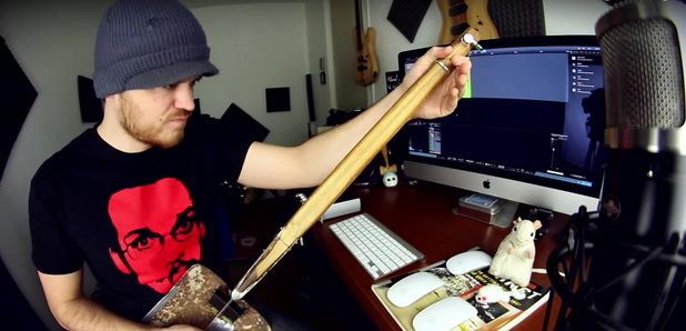 Guy plays guitar made out of a shovel Rob Scallion