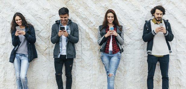 Teens on smartphones stock image