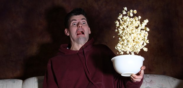 Man throwing popcorn in the air