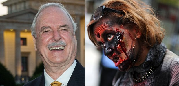 John Cleese with a actress posing as a Zombie for