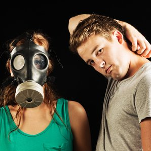 Smelly man and woman in gas mask