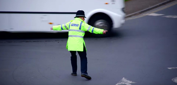 Policeman directs traffic by raver