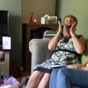 Woman reacts to getting surprised by Royal Blood t